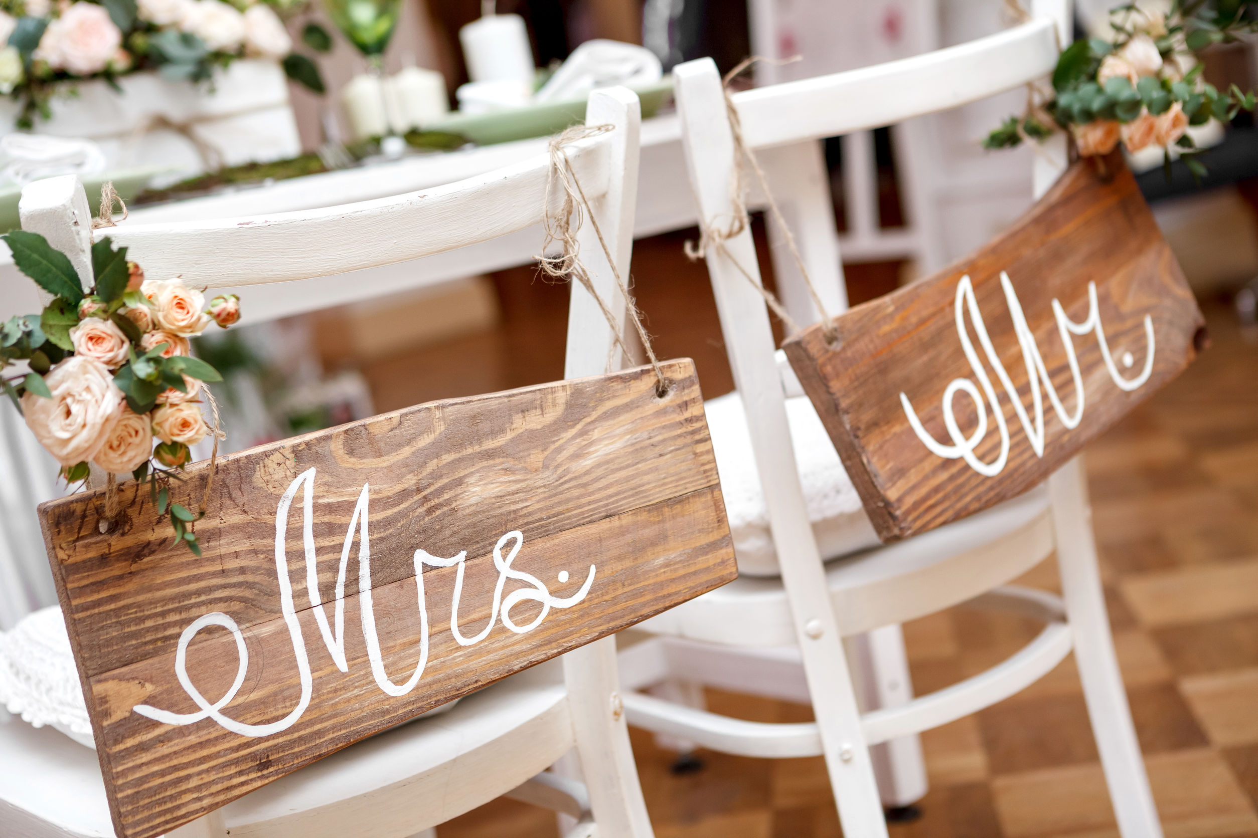 Wedding Catering Near me. A photo of a rustic barn wedding with Mr and Mrs signs oin the chairs.